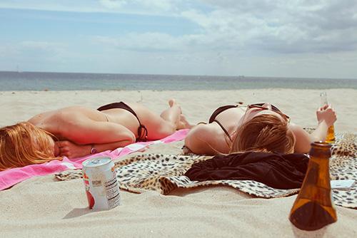 girls sun bathing image for Sun Safety Tips